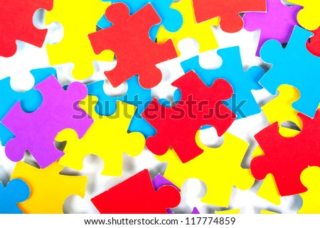 Children's color cardboard puzzles on a white background - stock photo