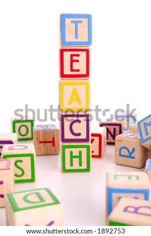 Children's colored blocks spelling the word teach and surrounded by other blocks - has clipping path