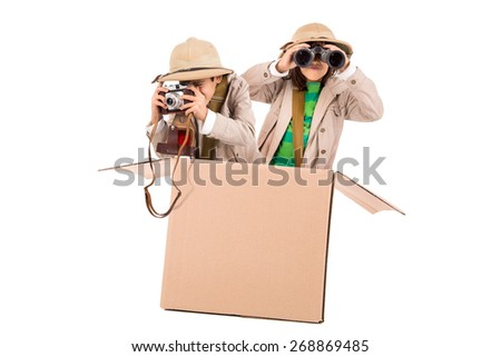 Children's couple in a cardboard box playing safari - stock photo