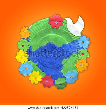 children's crafts - earth with flowers and bird on paper plate