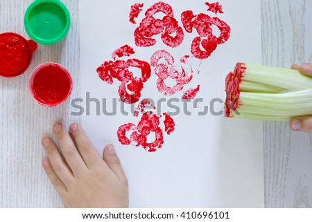 Children's creativity, drawing creation process. Bouquet of roses. - stock photo