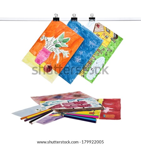 Children's drawings and colored pencils isolated on white background - stock photo