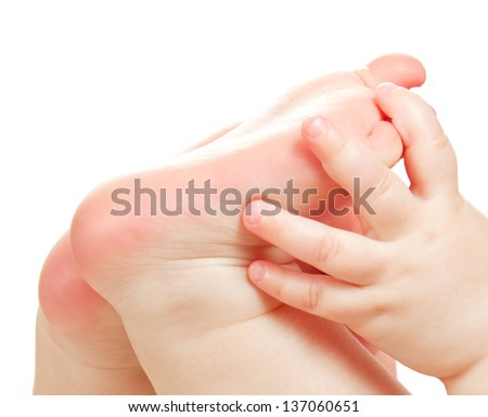 Children's feet and hand isolated on white