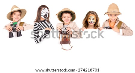 Children's group in safari clothes and face-paint over a white board - stock photo