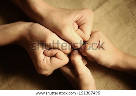 children's hands. agreed to team - stock photo