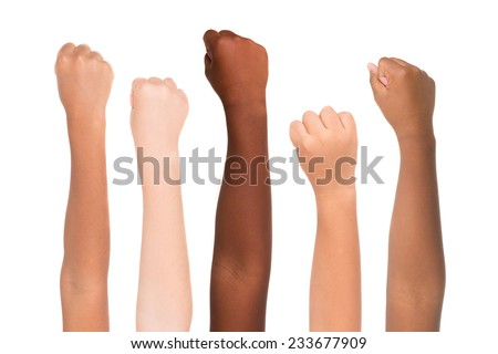 Children's hands from different colors and races together isolated in white - stock photo
