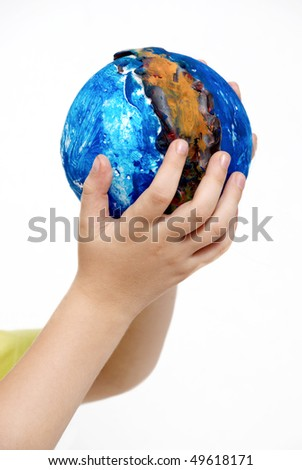 Children's hands holding globe made the child