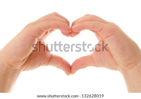 Children's hands show signs of heart. isolated on white - stock photo