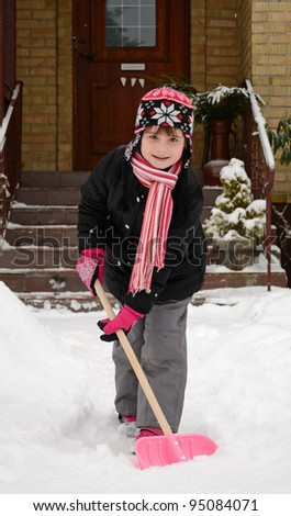 Children's help with winter cleaning - stock photo