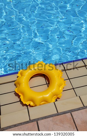children's inflatable circle on the edge of the pool - stock photo