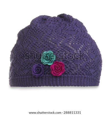 children's knitted hat with roses - stock photo