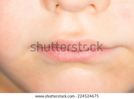 children's mouths. close-up - stock photo