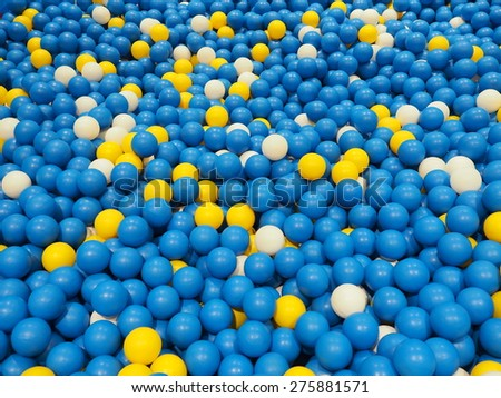 Children's party, a games room, a box filled with small colored balls.