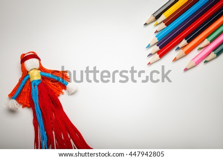 Children`s play background with colorful doll and pencil with empty space in center. - stock photo