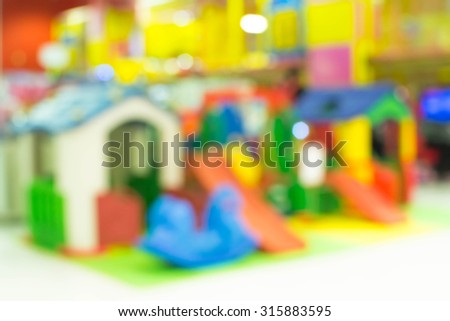 children's playground at department store for background usage, Defocused and blur image - stock photo