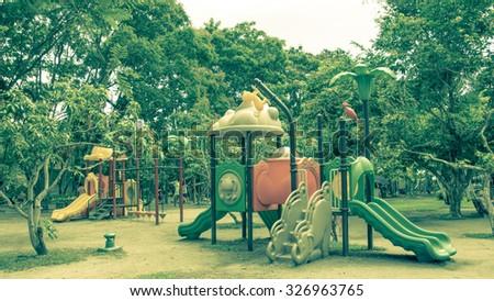 Children's playground at public park, vintage color style - stock photo