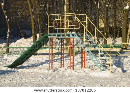 Children's playground in the winter. Moscow yard - stock photo
