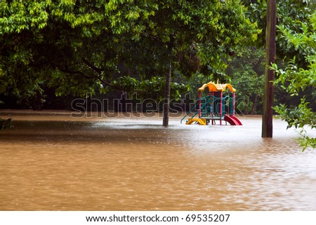 Children's playground under water after heavy rain and flooding in Queensland Australia - stock photo