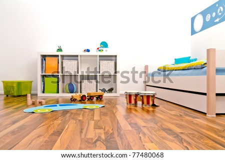 Children's Playroom with bed and rack and some toys - stock photo