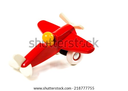 Children's red plane with a propeller on wheels isolated on white background - stock photo