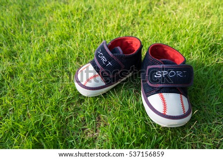 Children's shoes on grass.