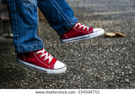 Children's shoes. Stylish children's shoes. Fashion. Sneakers - stock photo