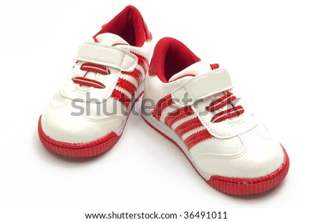 Children's sport shoes, isolated on white - stock photo