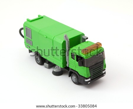 children's toy garbage in green on a white background