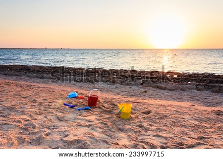 Children's toys on the shores of the Red Sea in Egypt - stock photo