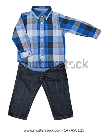 Children's wear - blue plaid shirt with a long sleeve and jeans - stock photo
