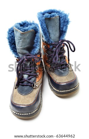 Children's winter shoes isolated over the white background - stock photo