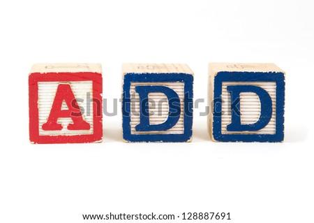 "Children's wooden blocks ""ADD"" Attention Deficit Disorder on white background - stock photo"