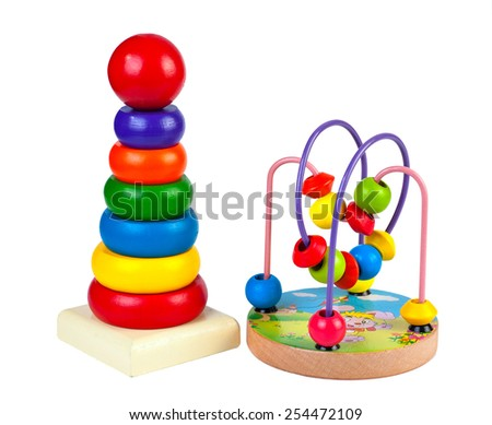 Children's wooden toys and pyramid maze isolated on white background - stock photo