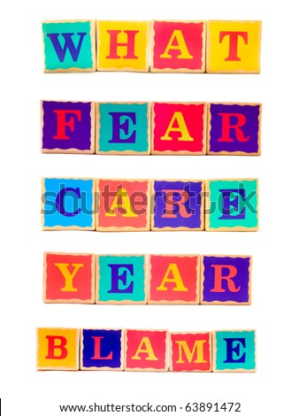 Children's wooden word building blocks arranged to spell What, Fear, Care, Year, Blame - stock photo