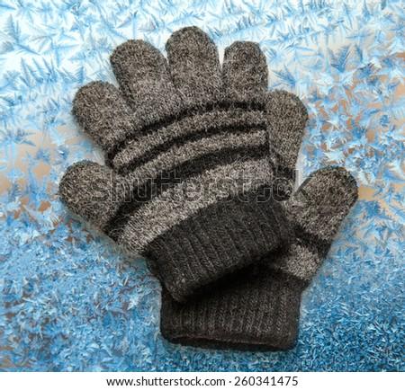 Children's woolen gloves on the white background - stock photo