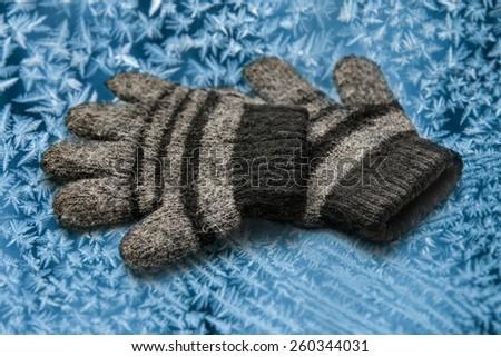 Children's woollen gloves on the white background - stock photo