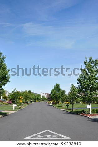Children School Crossing Traffic Sign on street of beautiful quiet suburban residential neighborhood on spring blue sky day - stock photo