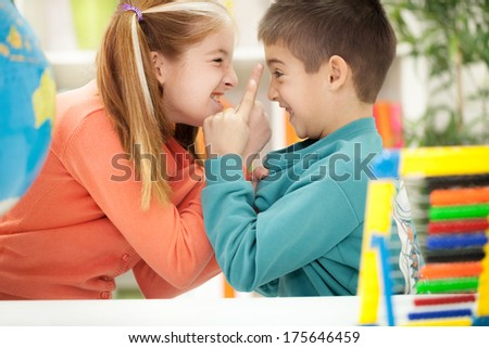 children shouting to each other at home - stock photo