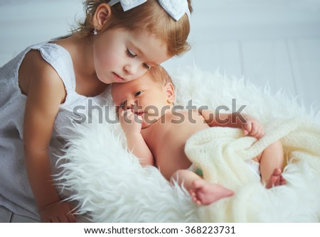 children sister and brother  newborn baby on a light background - stock photo