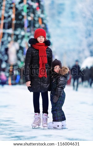 Children skating on Christmas - stock photo