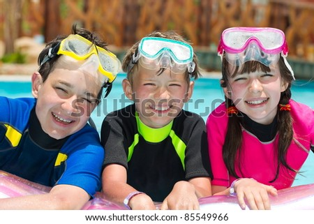 Children snorkeling in pool - stock photo