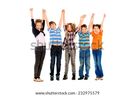 Children stand and wave their hands for joy. Isolated over white. Full length portrait.