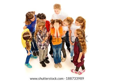 Children stand around crying girl. Isolated over white. - stock photo