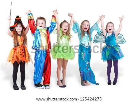 children stand holding hands and lifting them up and shout - stock photo