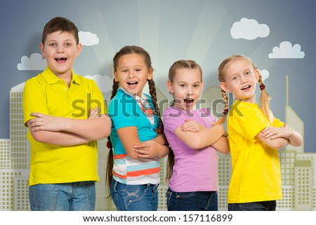 children stand in a row and smile