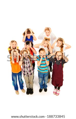 Children stand together and something surprised. Isolated over white. - stock photo