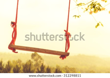 Children swing in the park (vintage tone) - stock photo