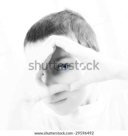 children thinking about the future of our earth. Earth in is eye. - stock photo