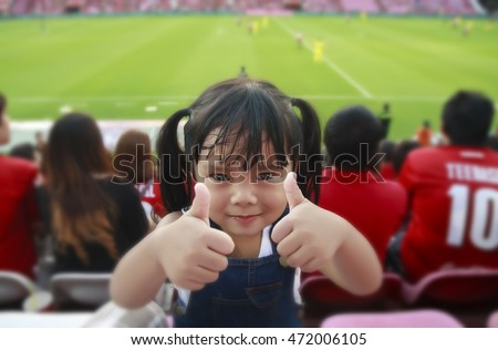 children thumb finger show for cheer football or soccer at stadium, fan club