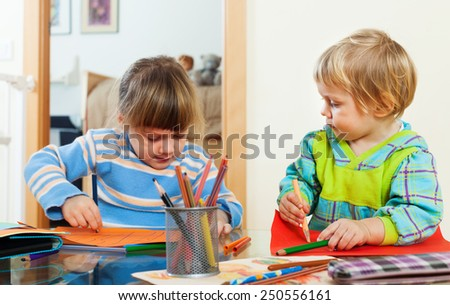 children together with pencils in home interior